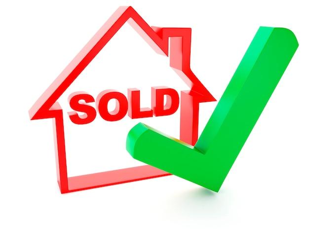 Casa vendida y marca de verificación sobre fondo blanco