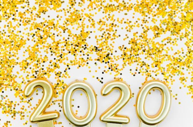 Celebración de año nuevo 2020 y brillo dorado