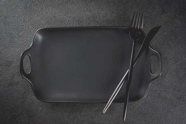 Cena de superficie con tenedor y cuchillo