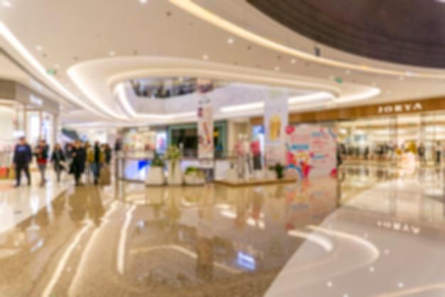 Centro comercial abstracto de la falta de definición del interior de los grandes almacenes para el fondo