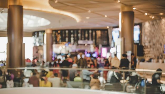 Centro comercial borroso en el interior con luz para el concepto de estilo de vida