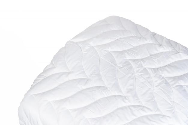 Cerca de una nueva manta aislada sobre fondo blanco.