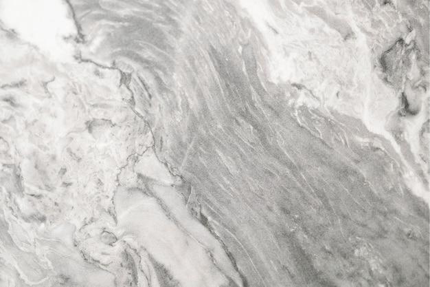 Cerca de una pared de mármol con textura