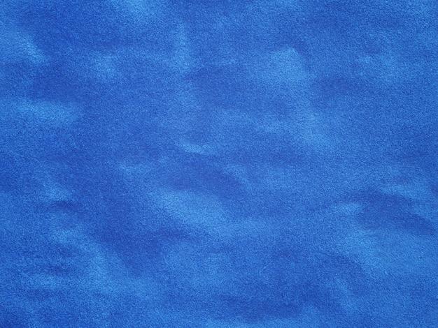 De cerca la superficie de fondo de terciopelo azul con textura
