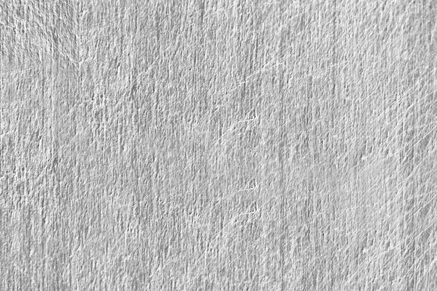 Cerca de una textura de muro de hormigón rayado gris
