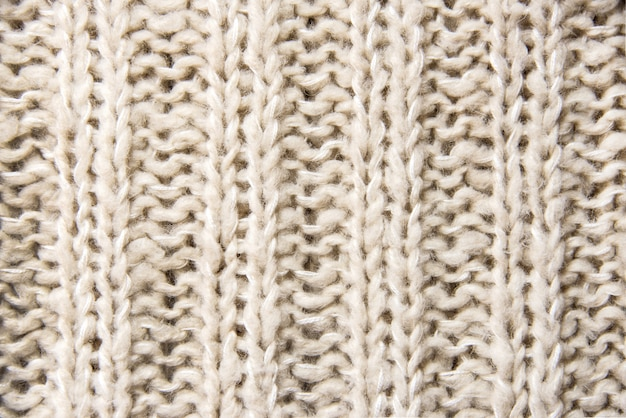 Cerca de la textura de punto de lana