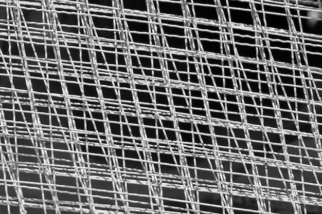 Cercado industrial de la alambrada de acero. cierre la textura neta del alambre de acero para el fondo.