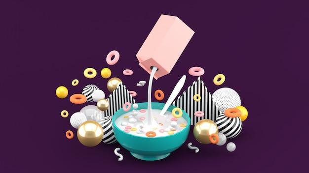 El cereal y la leche se encuentran entre las bolas coloridas en el espacio morado