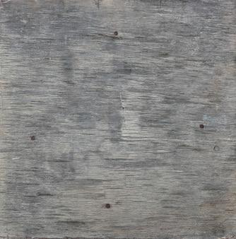 Cerrar textura de fondo de tablones de madera gris degradado vintage con nudos y manchas