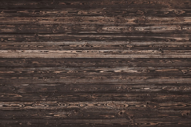 Cerrar textura de fondo de tablones de madera marrón degradado vintage con nudos y manchas