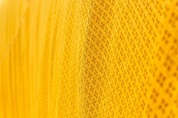 Cerrar la textura de la túnica amarilla
