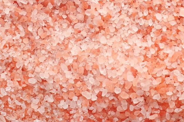 Cerrar vista superior del fondo de textura de sal rosa del himalaya con alta resolución.