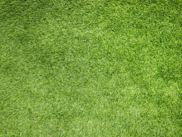 Césped artificial verde. textura de fondo de colocación de césped artificial.