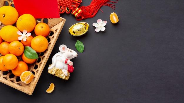 Cesta de mandarina y rata año nuevo chino
