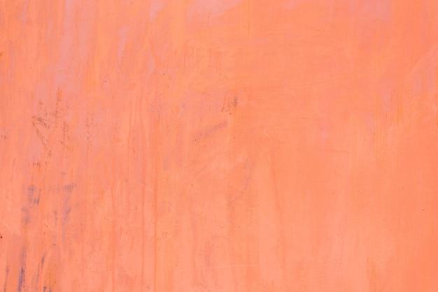 Chapa pintada con pintura de metal coral. textura de fondo copiando espacio