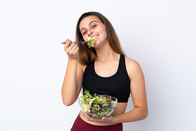 Chica adolescente con ensalada