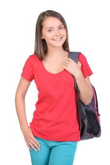 Chica adolescente con mochila escolar.