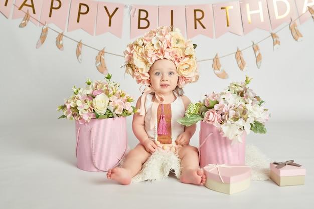 Chicas de primer cumpleaños, decoración en colores rosa.