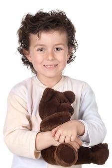 Chico guapo en pijama con oso de peluche
