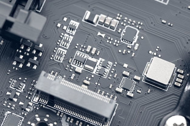 Chip de circuito electrónico de una placa base de computadora. tecnología de fondo abstracto