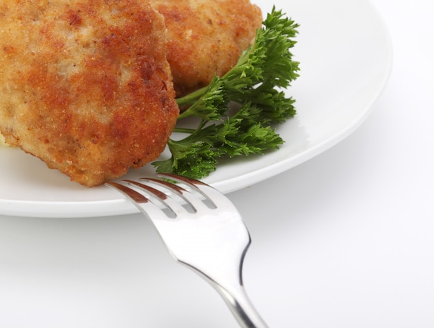 Chuletas asadas con tenedor