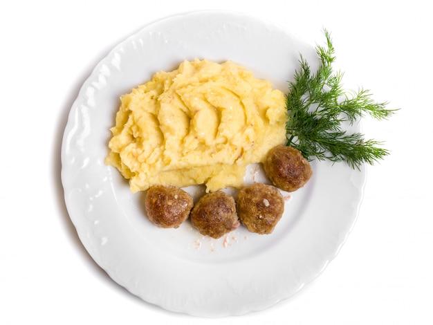Chuletas con carne y puré de papas