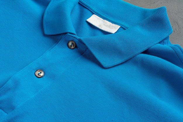 Cierre azul de la textura de la camiseta del polo del algodón para arriba. moda de hombres