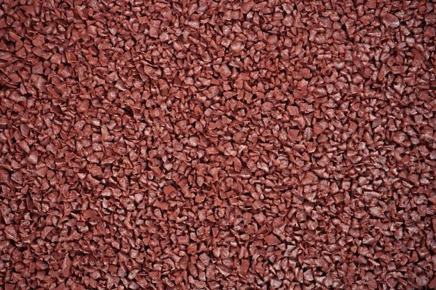 Cierre de fotograma completo en rojo textura de goma pista runing