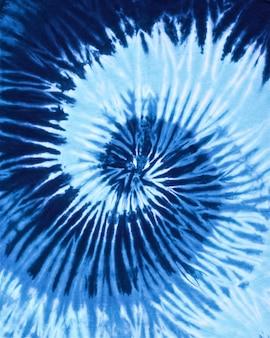 Cierre plano de espiral color azul tono tie dye textura de la tela de fondo