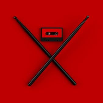 Ciérrese para arriba del casete de la cinta de audio del vintage con el ejemplo del concepto de los palillos en backgr rojo