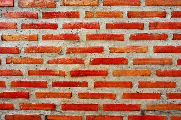 Ciérrese para arriba de fondo rojo de la textura de la pared de ladrillo.