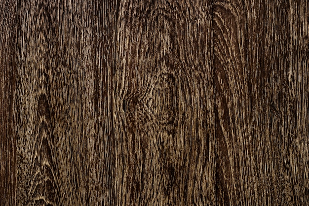 Ciérrese para arriba de un fondo textured suelo de madera marrón