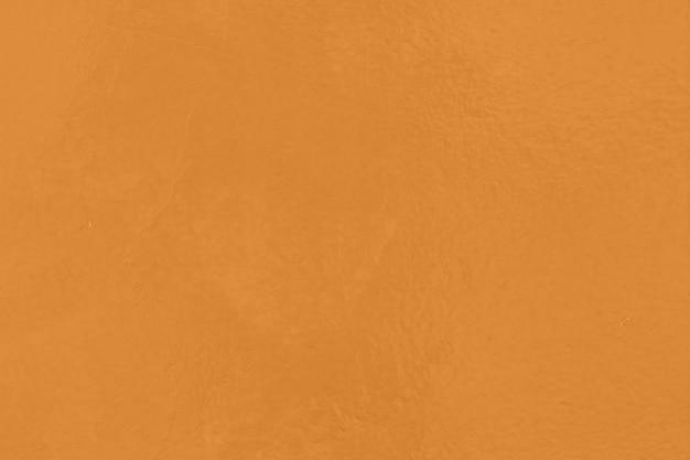 Ciérrese encima de fondo anaranjado de la textura del papel