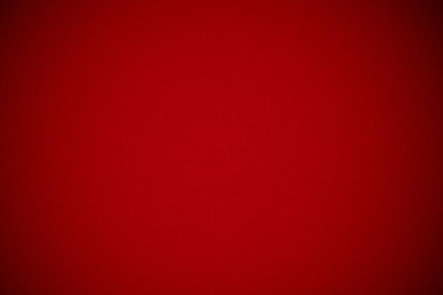 Ciérrese encima de fondo rojo de la textura del papel