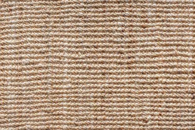 Ciérrese encima de fondo de la textura de la harpillera.