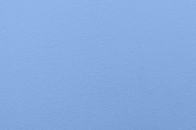 Ciérrese encima de fondo de la textura del papel azul
