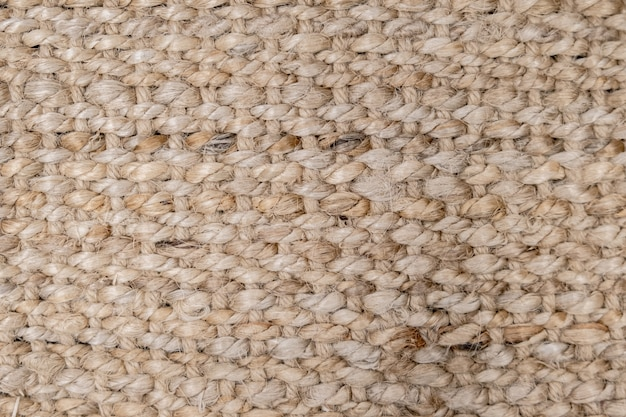 Ciérrese encima de la superficie de estera natural del sisal, fondo de la textura