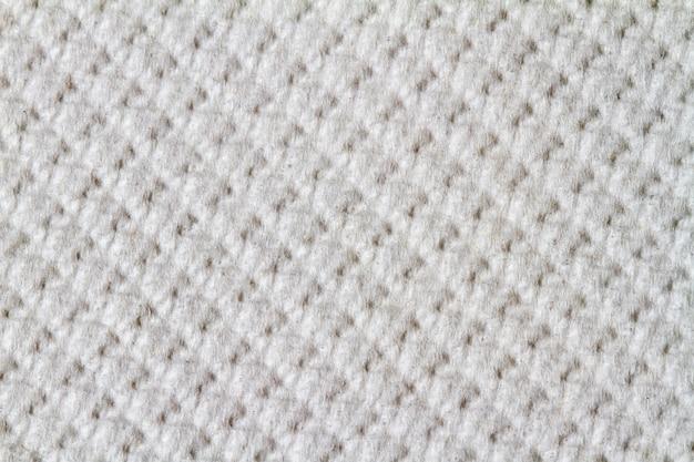 Ciérrese encima de vista de la textura blanca lisa de la tela de las lanas.