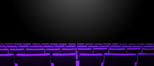Cine sala de cine con filas de asientos de color púrpura y una superficie de espacio de copia negra