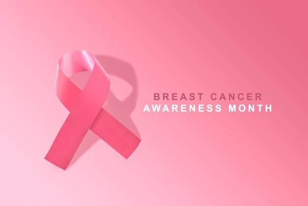 Cinta de conciencia rosa sobre fondo rosa. conciencia del cáncer de mama