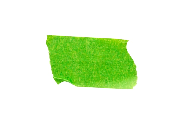 Cinta de papel adhesivo verde aislado sobre fondo blanco.