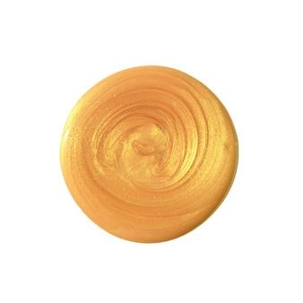Círculo dorado de pintura. trazo de pincel dorado aislado sobre fondo blanco. textura de belleza. vista plana endecha, superior.