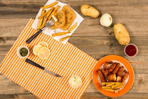 Círculo de platos fritos e ingredientes para cocinar.