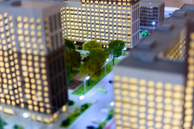 Ciudad del juguete. efecto de desenfoque de cambio de inclinación. el paisaje urbano de la urbanización moderna vista aérea de los rascacielos.
