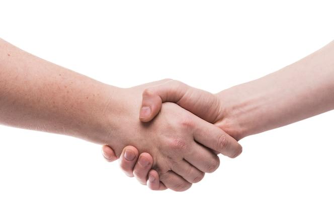 Close-up apretón de manos en blanco