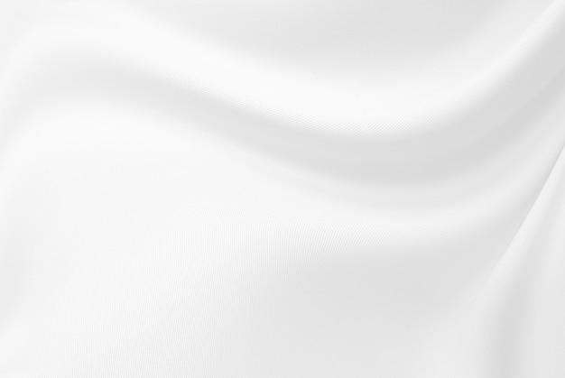 Closeup elegante arrugado de tela de tela de seda blanca y textura.