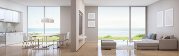 Cocina con vistas al mar, comedor y sala de estar de la casa de playa de lujo en un diseño moderno.