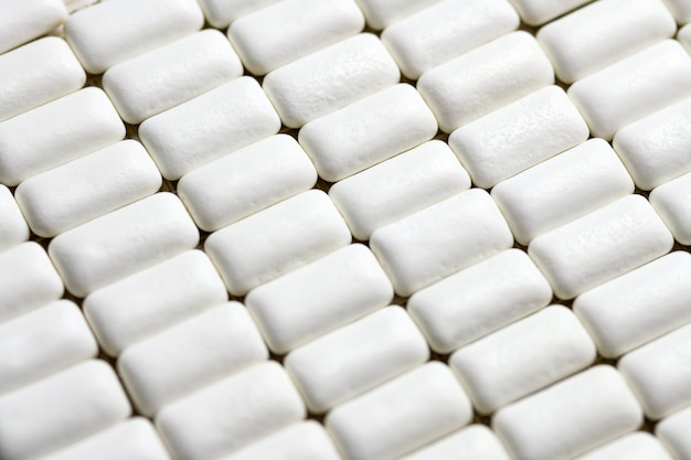 Los cojines del chicle se cierran para arriba. la higiene bucal y los dientes protegen de las caries.
