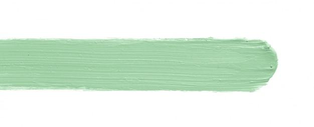 Color verde que corrige el trazo del corrector aislado