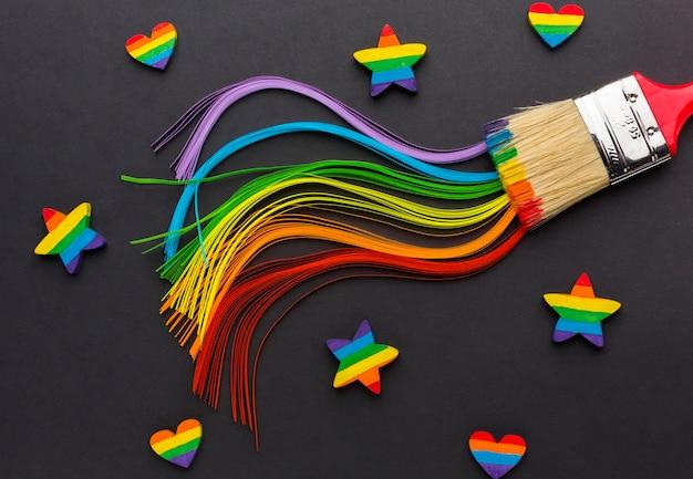 Colores ondulados y pincel con estrellas